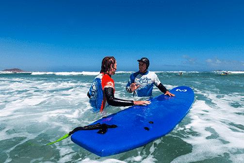 surf instructor of our surf school always neaby famara lanzarote уроки серфинга для начинающих redstarsurf